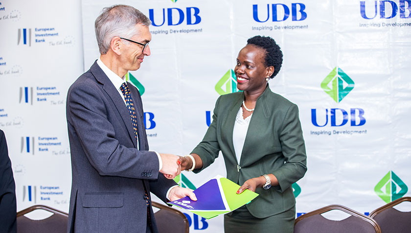 Robert Schofield, Head of EIB's Financial Sector Division covering Africa with Patricia Ojangole, UDB Managing Director.